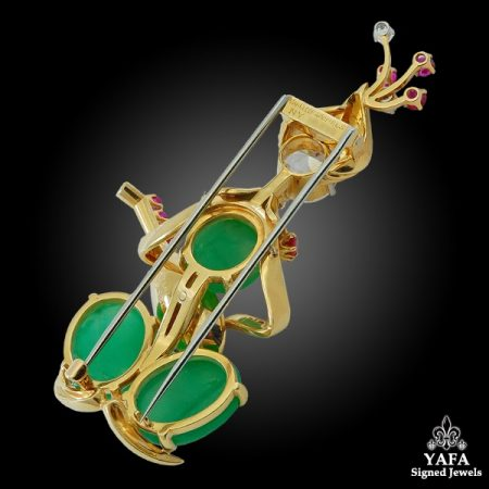 VAN CLEEF & ARPELS Ruby, Cabochon Emerald, Diamond Star Player Brooch